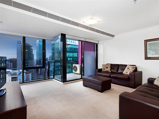 Living area facing Crown Casino and balcony